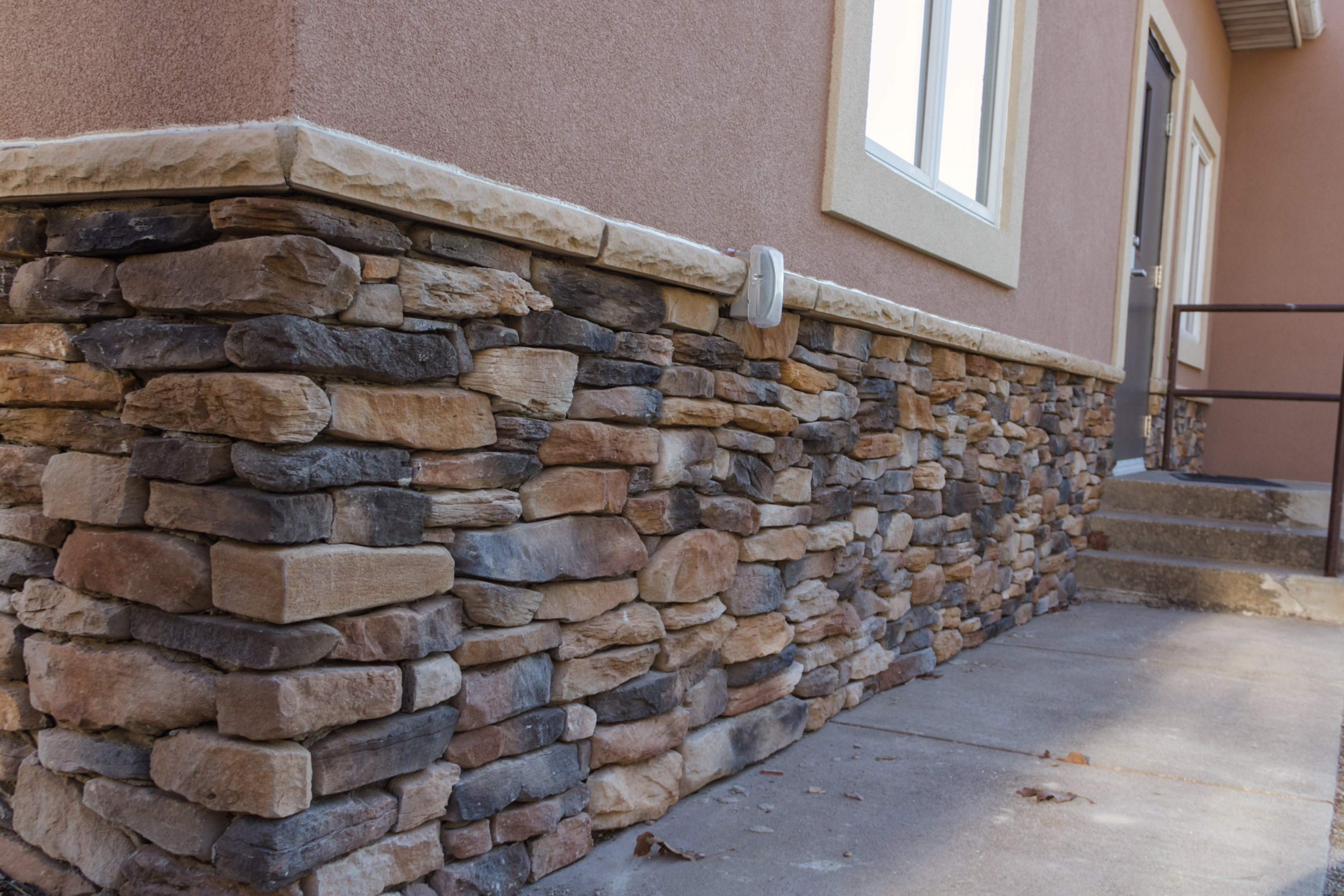 Stucco for How to install stone veneer over stucco